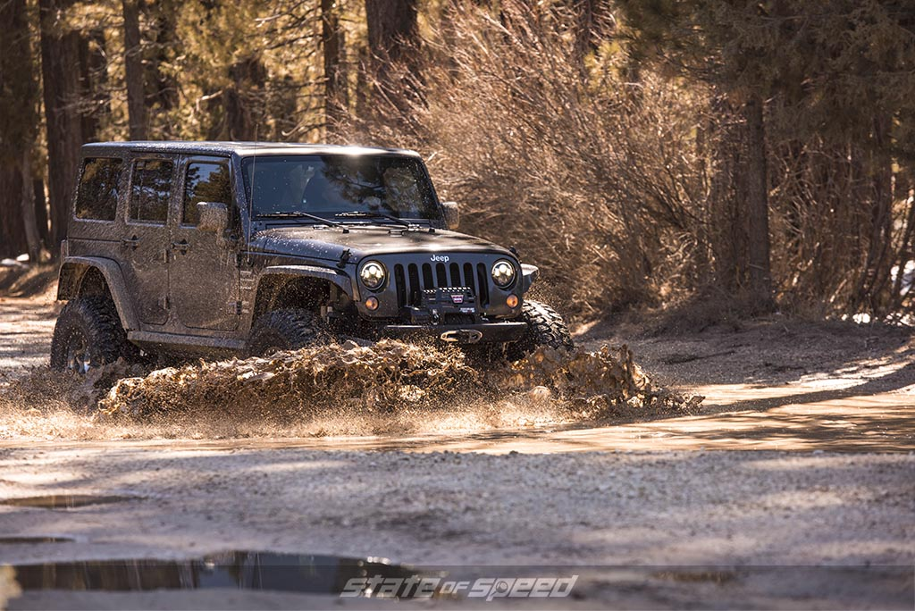 jeep jk in the mud on milestar tires