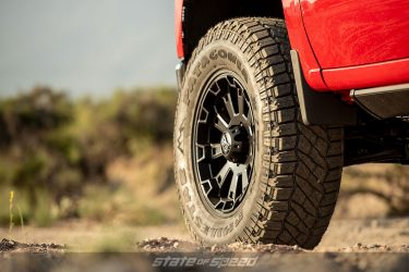red chevy silverado with XT tires for off road extreme conditions
