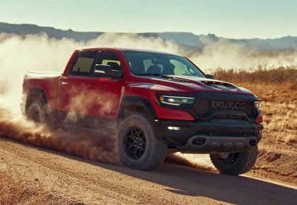 Red RAM 1500 TRX running through the desert