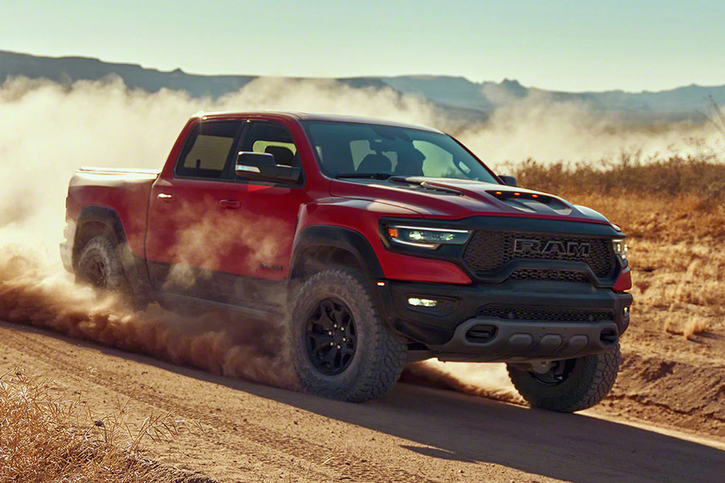 Red RAM 1500 TRX running through the desert