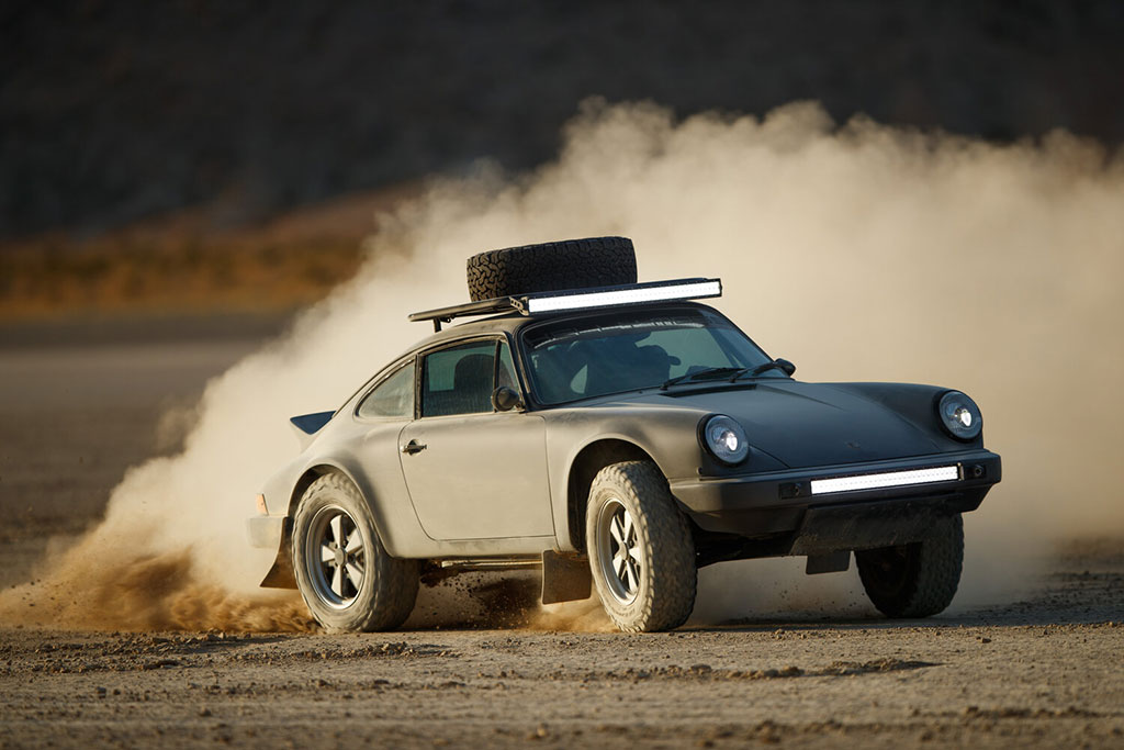Kelly Moss Racing built porsche 911 safari driving in the dirt