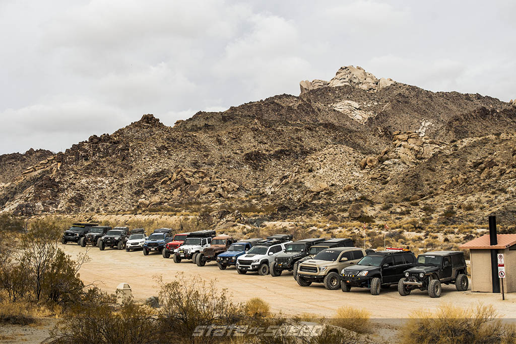 lineup of milestar rigs ready to overland