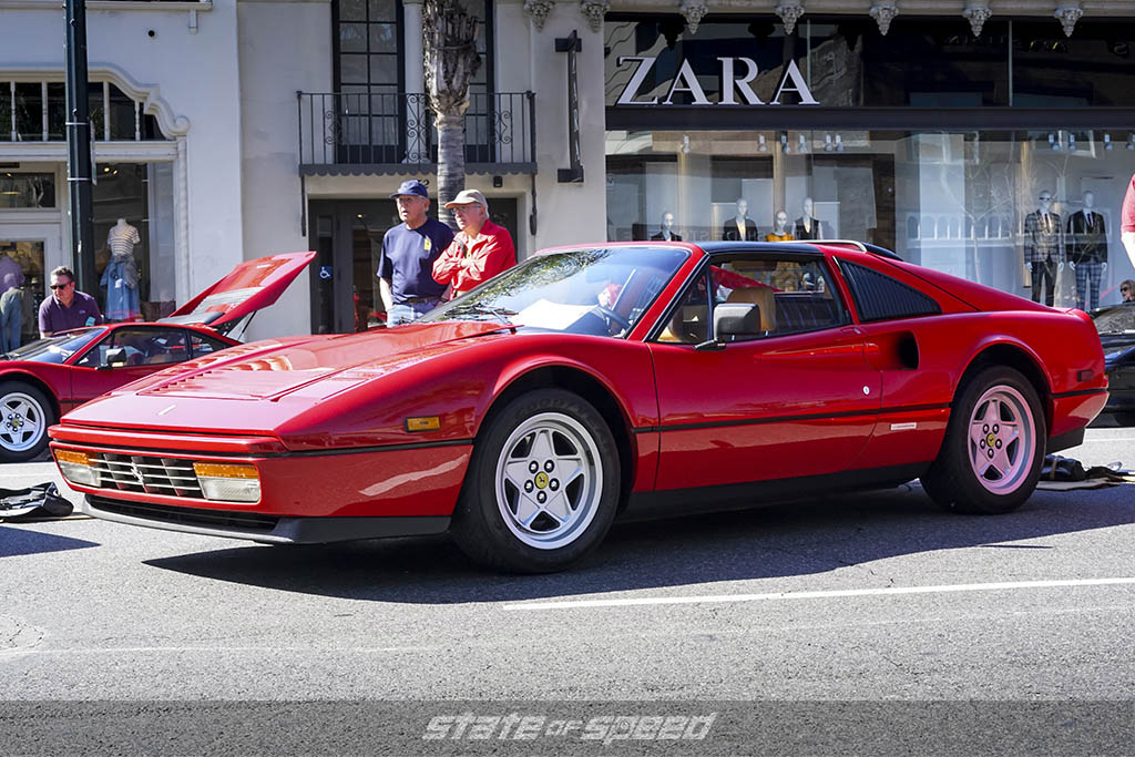 side shot of ferrari 328 in red
