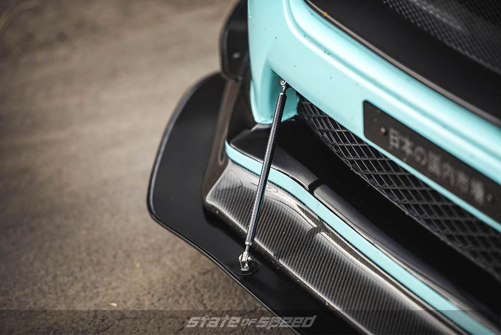 blue subaru wrx with carbon fiber lip and splitter