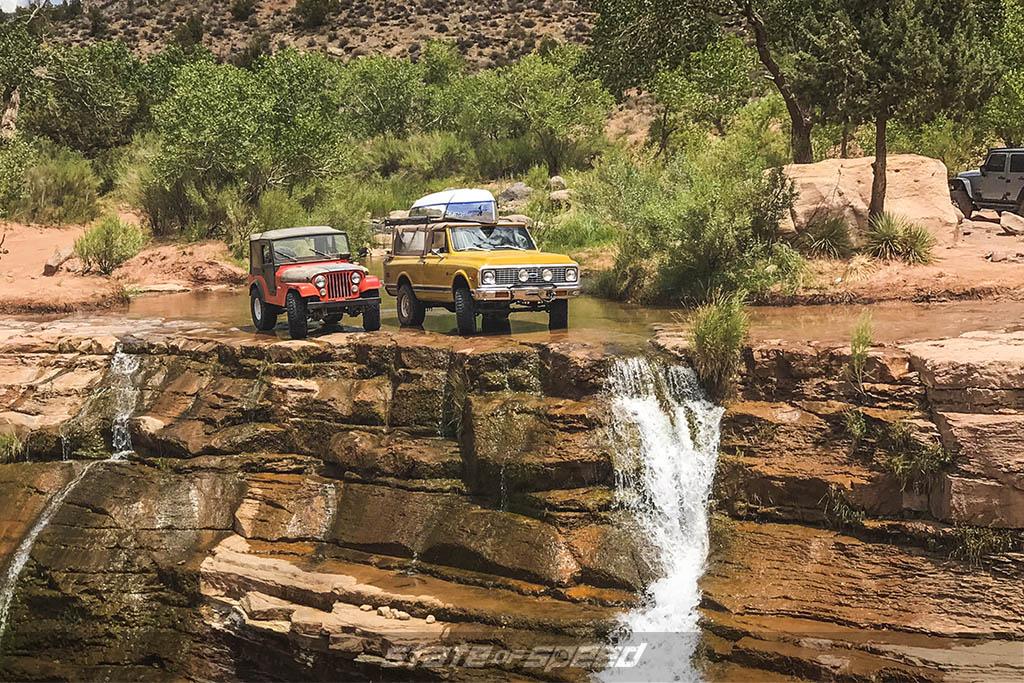 cj5 and k5 blazer in utah by a waterfall
