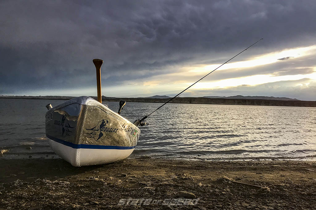 canoe on a lake in utah during sunset