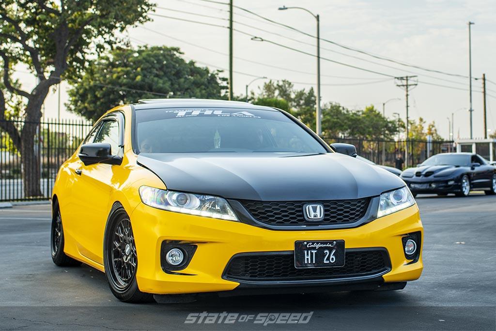 Yellow Honda Accord with a black hood