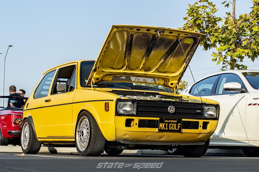 Yellow Volkswagen Mark 1 Golf Rabbit with hood open