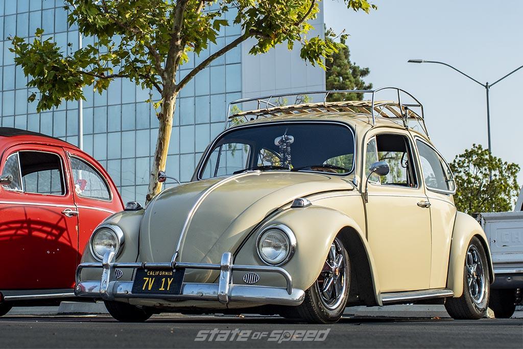 Tan 1949 Volkswagen Beetle in front of Tireco Corporate building