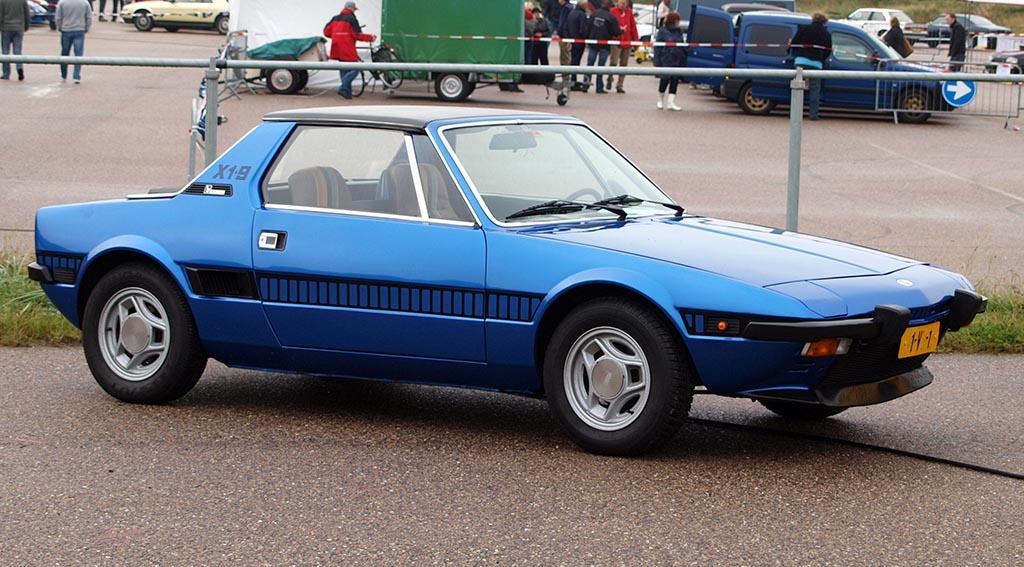 Blue 1974 Fiat X1/9 at a car park