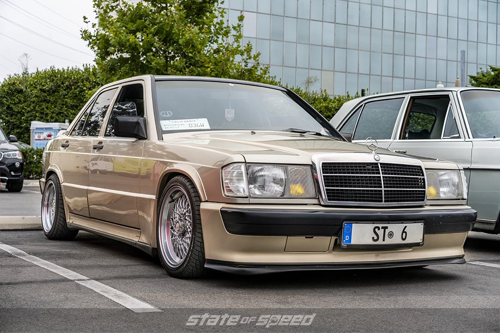 brown 1983 Mercedes W201 in front of the Tireco corporate building
