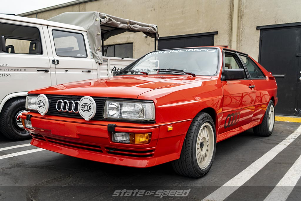 Red 1983 Audi Quattro parked at a car meet