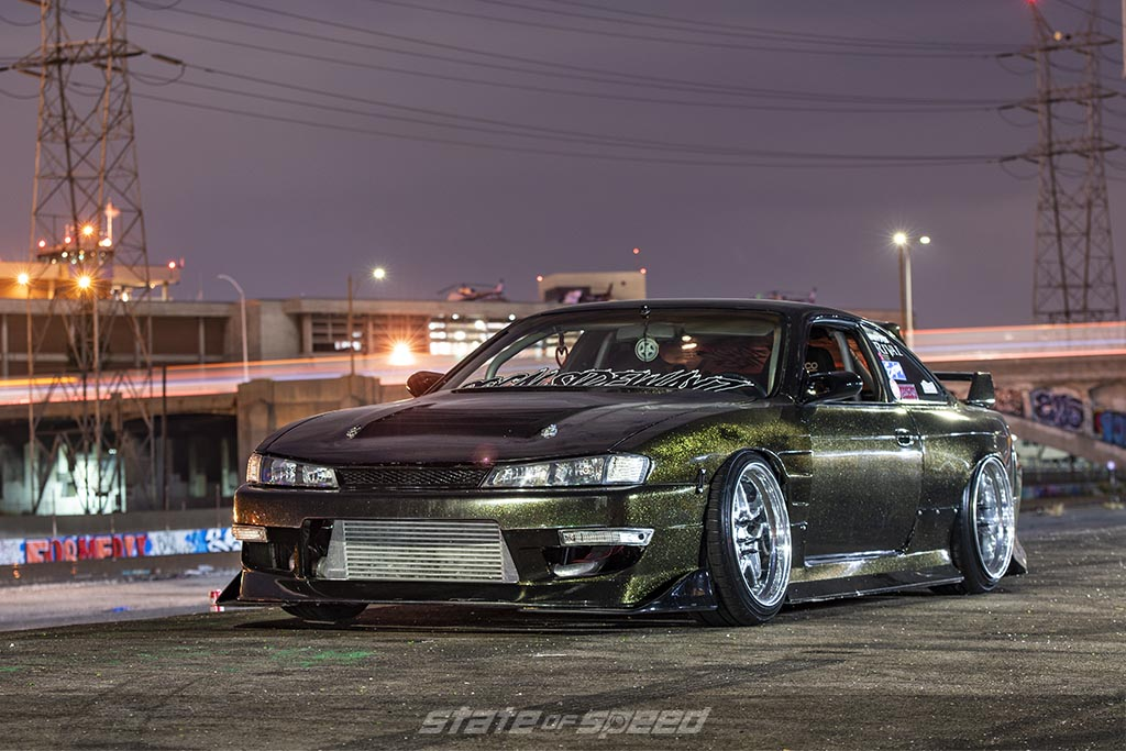 Green Nissan 240SX S14 with a modified Nissan SR-Series Engine