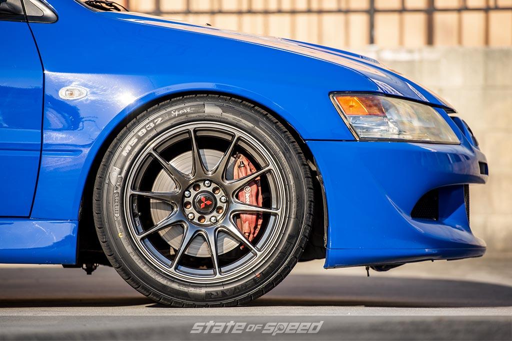 blue mitsubishi lancer evolution on milestar MS932 Sport tires and brembo brakes