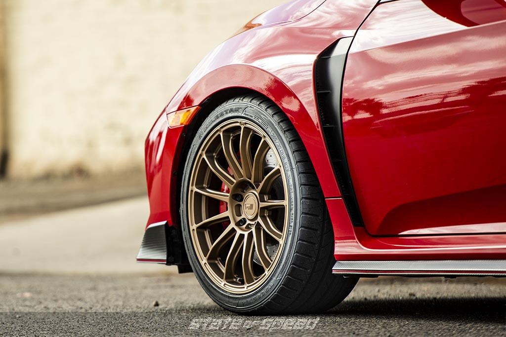 red honda civic type r with milestar tires wrapped around motegi wheels