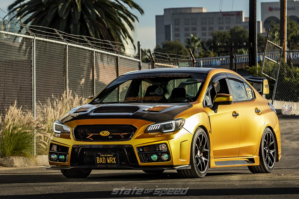 Yellow Subaru WRX During a sunset in a city