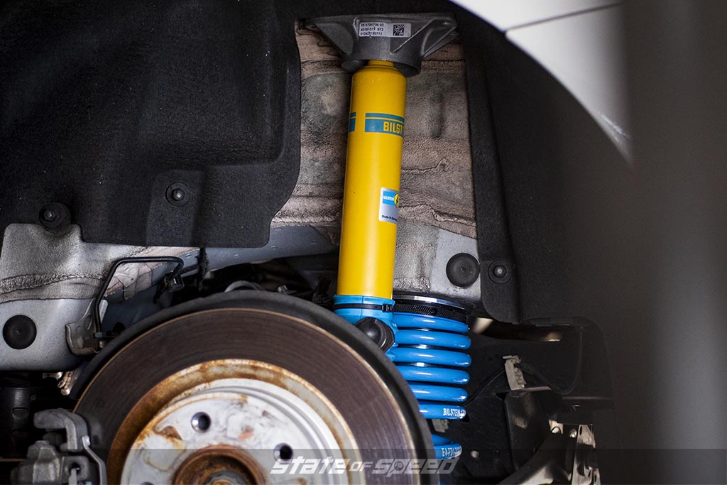 Yellow and blue Bilstein coilovers on a BMW