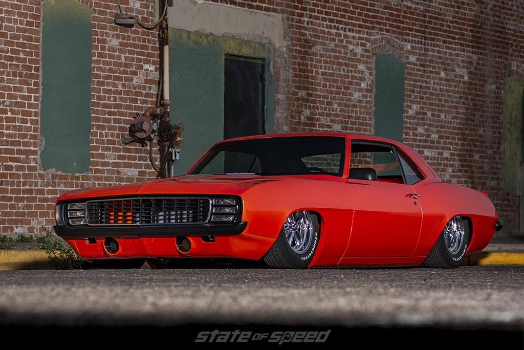 Close up of the bags on an Air Suspension system in a orange '69 Chevrolet Camaro Muscle car