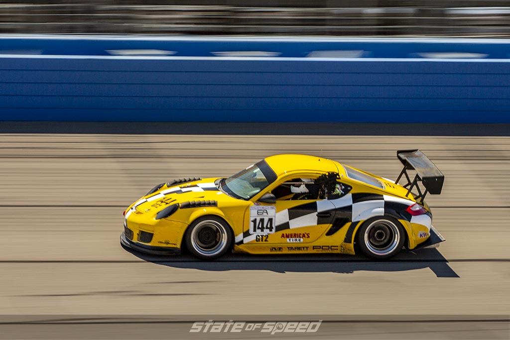 yellow porsche 911 GT2 speeding through a track on a track day